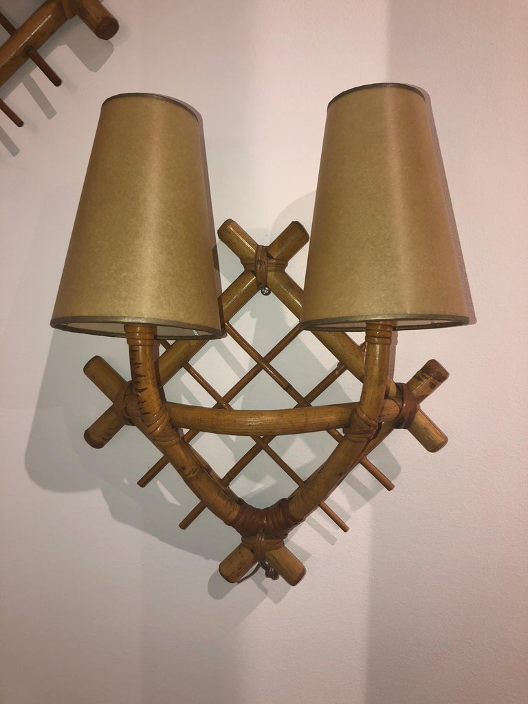 Pair of wicker sconces after Jean Royère, France, 1950.