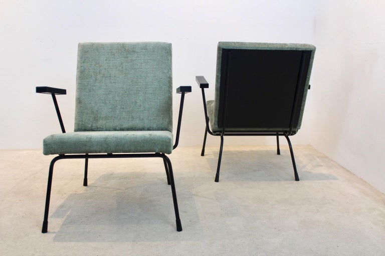 Beautiful pair of Wim Rietveld no. 1407 lounge chairs for Gispen with stunning new green soft velours upholstery. Black enameled metal frames and black bakelite armrests. Frames in original Condition with some small signs of wear. Set price. This