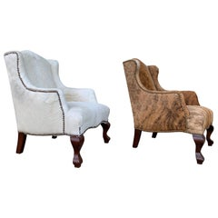 Pair of Wingback Chairs 1 in Brown Cowhide and 1 in White Cowhide Leather