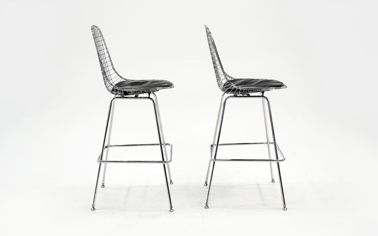 American Pair of Wire Barstools by Charles and Ray Eames, Chrome with Black Leather Pads For Sale