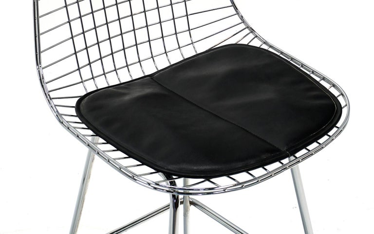 Pair of Wire Barstools by Charles and Ray Eames, Chrome with Black Leather Pads In Good Condition For Sale In Kansas City, MO