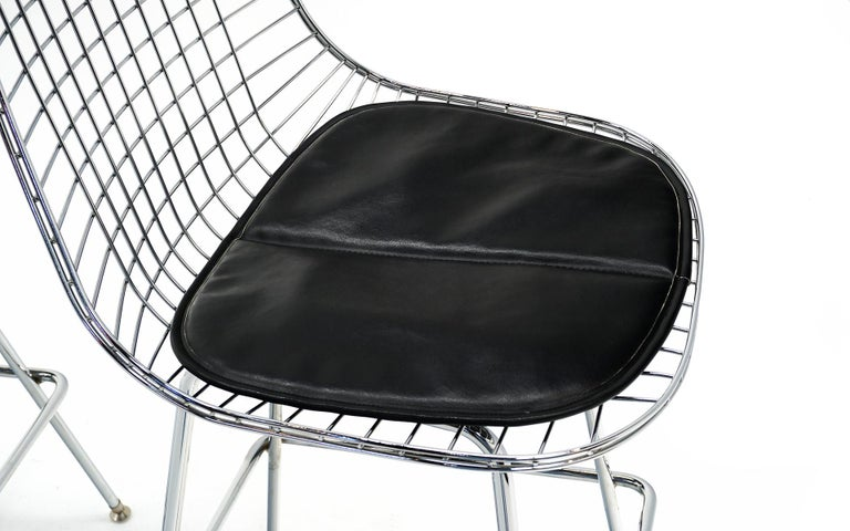 Contemporary Pair of Wire Barstools by Charles and Ray Eames, Chrome with Black Leather Pads For Sale