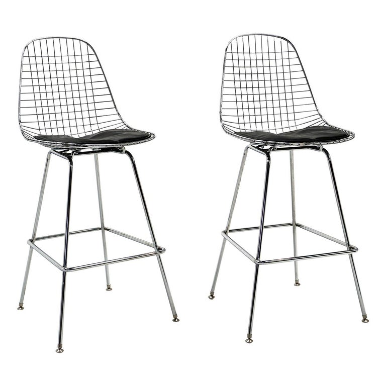 Pair of Wire Barstools by Charles and Ray Eames, Chrome with Black Leather Pads For Sale