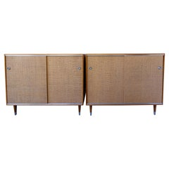 Pair of Wood Cabinets with Sliding Grass Covered Doors, by Herman Miller