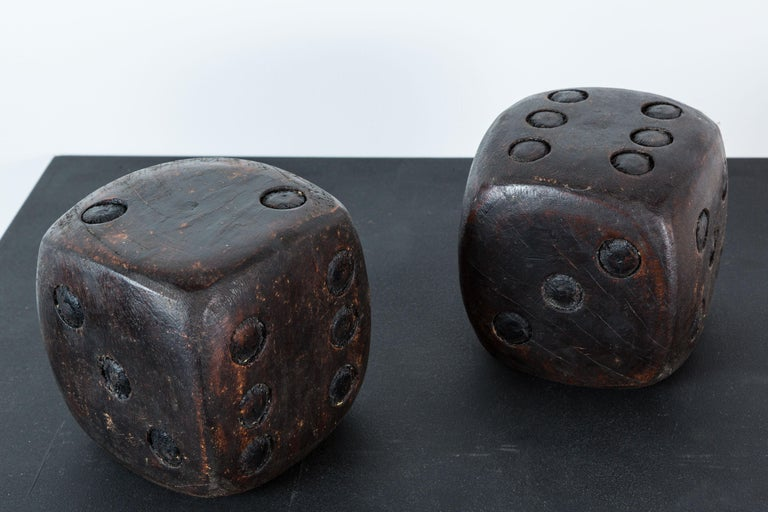 Pair of nicely carved Folk Art dice. Quite heavy and solid. Original stained surface.