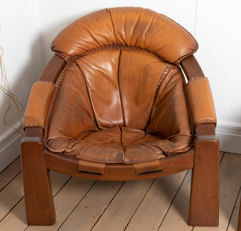 Pair of wood frame and leather armchairs.