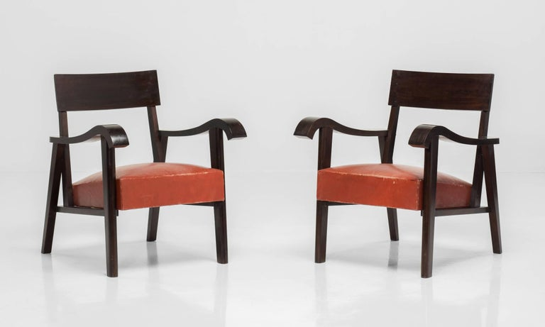 Elegant forms with substantial weight and original leather upholstery; England, circa 1940.