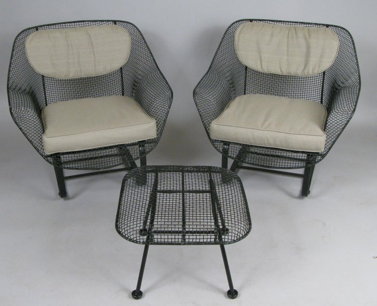 A pair of classic vintage 1950s 'Sculptura' lounge chairs by Russell Woodard. The most comfortable and desirable of Russell Woodard's classic and iconic 'Sculptura' collection, the lounge chair is formed entirely of woven steel mesh, mounted on a