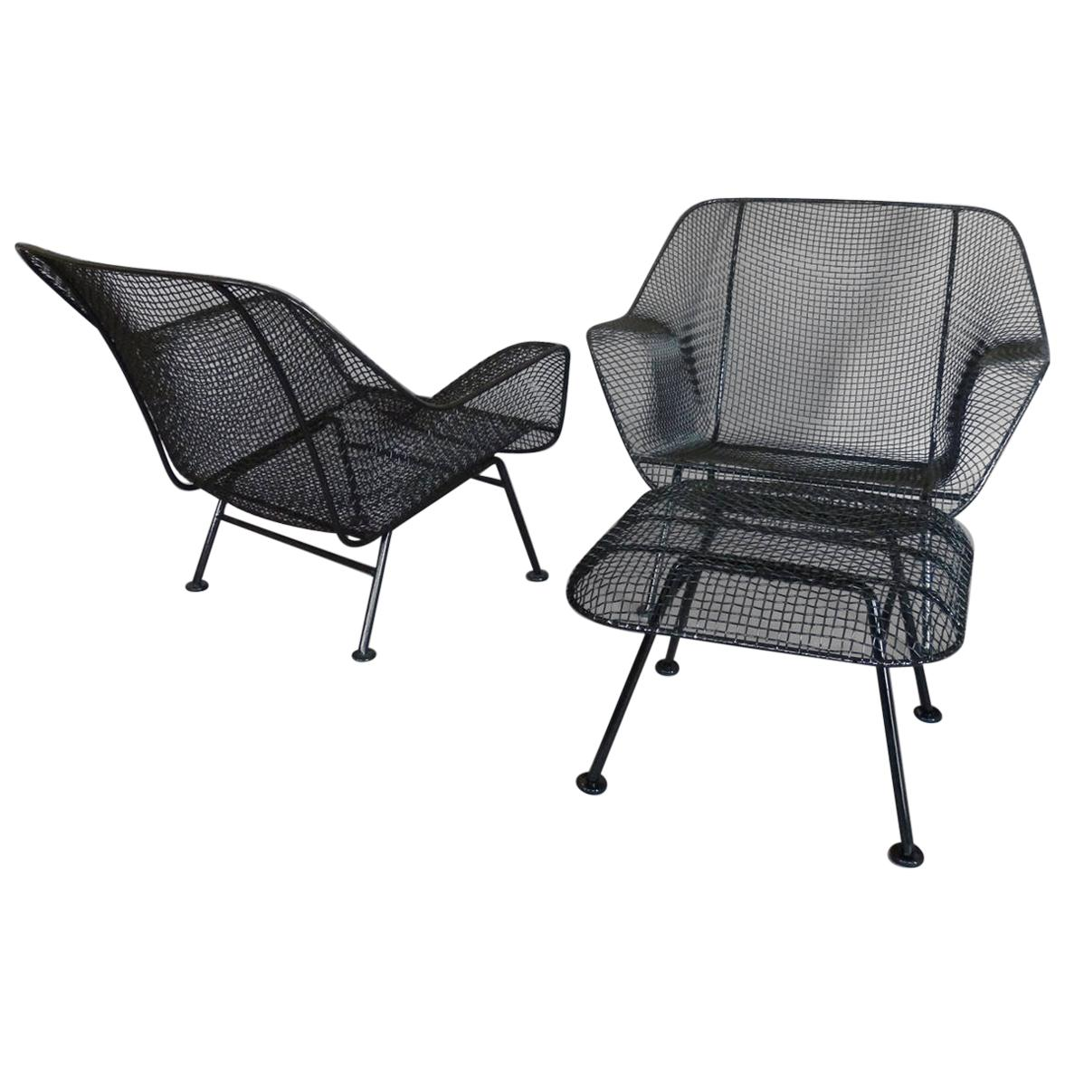 Pair of Woodard Wrought Iron and steel Mesh Lounge Chairs with matching ottoman