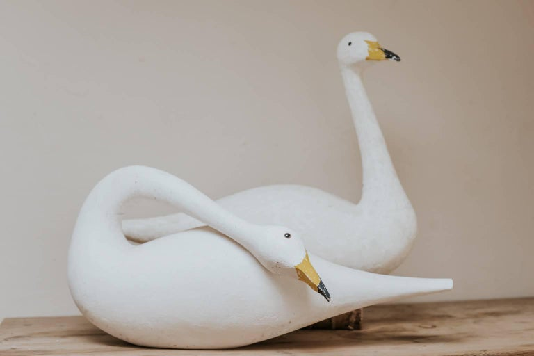 This pair of wooden decoy swans were made by Martin Scorey, British contemporary artist, born 1961, great decorative items.