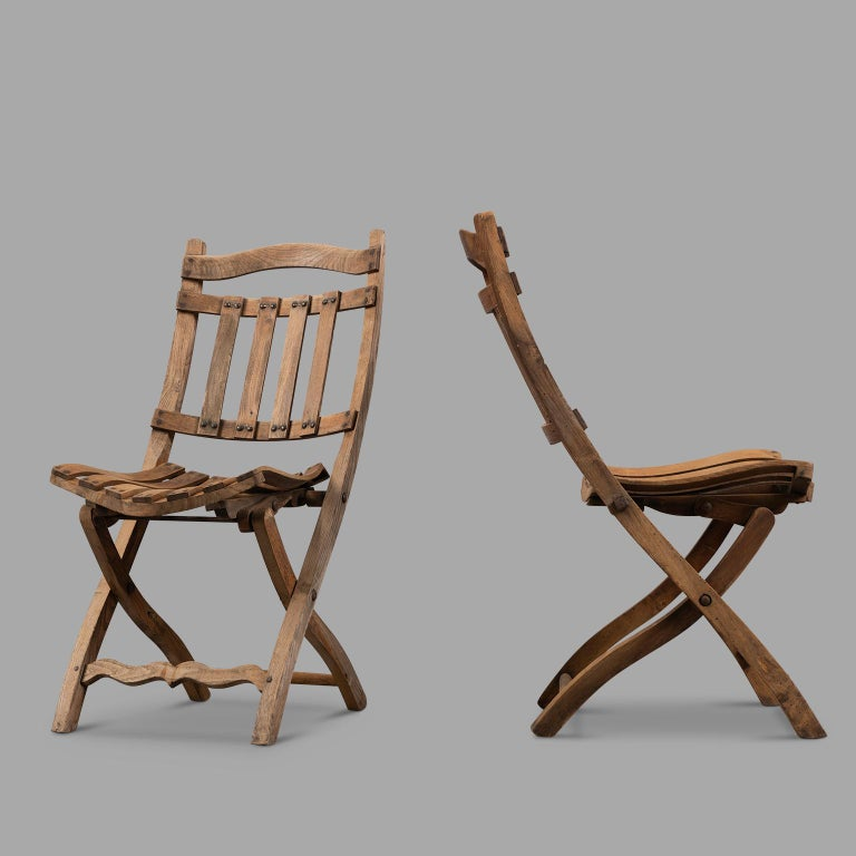 Beautiful time patina for these two unusual shape chairs made of walnut tree. South of France popular work, circa 1900.  Measures: Total height 84cm, width 40 cm, depth 45. Seat height 43 cm.
