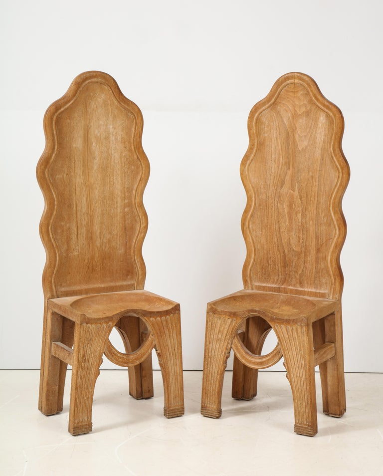 An extremely rare pair of hand-crafted wooden replicas  of the famous stone throne from the Minoan Palace at Knossos, Crete. The original artifact dates from c. 1,600 b.c.  It was excavated by Sir Arthur Evans during the first years of the 20th