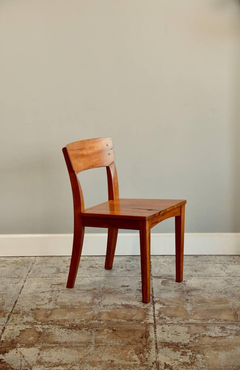 Great pair of woodworker studio chairs. Imperfections in the wood have been kept. Marked.