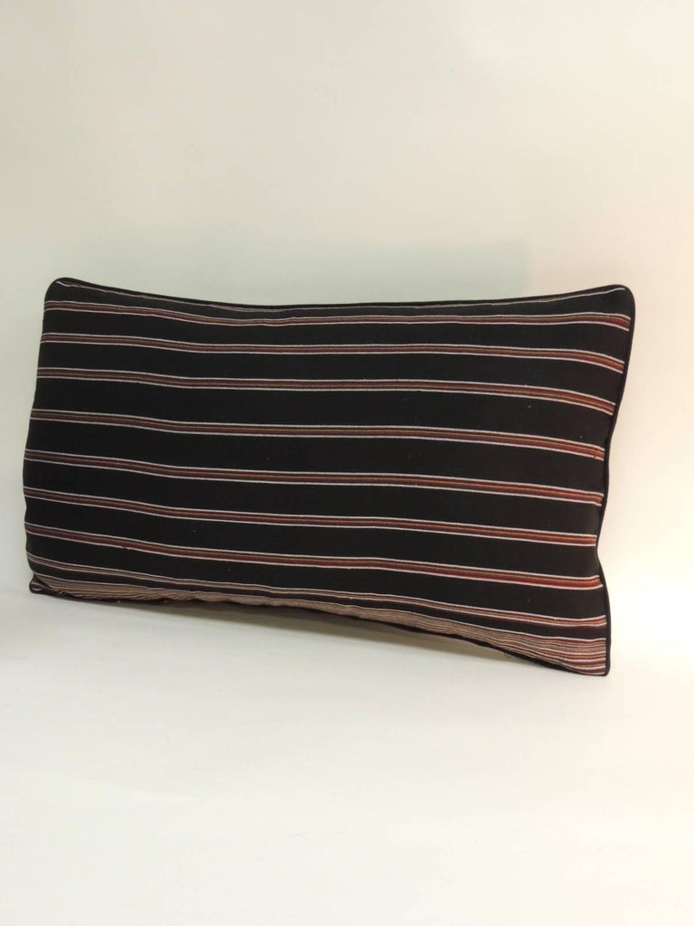 Pair of Woven Obi Red and Black Stripes Lumbar Decorative Pillows. in shades of black and red stripes with a small cotton custom-made piping all around and  black linen backings.  Decorative bolster pillows handcrafted and designed in the USA.