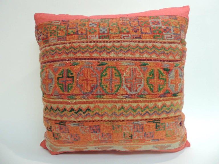 Pair of woven tribal design colorful pillows. Stripes and geometric pattern woven with colorful yarns.  Framed with red linen all around and natural linen backings. In shades of orange, yellow, green, red, blue, grey and purple. Boho-chic style