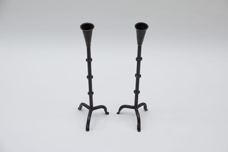 Super decorative.  These two candleholders measure 55cm in height and 15cm in width.  The top diameter measures 4cm and tapers to 2.5cm at the bottom.