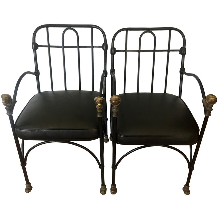Pair of wrought iron and bronze chairs after Giacometti - A handsome pair of chairs in the Manner of Giacometti - each chair has bronze details, however one is a spherical shape and the other a dog (see image details) both have the same style feet.