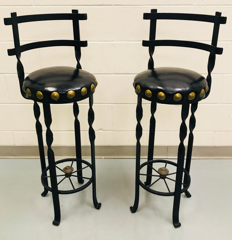 Pair of wrought iron bar or counter stools.