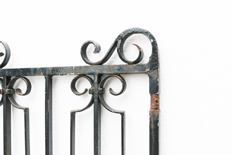 About  A good quality pair of English wrought iron garden gates.  Condition report  Gates in excellent structural condition, there is a working latch and gate stay, no hinges present. Finished in old black paint.   Style  Victorian /