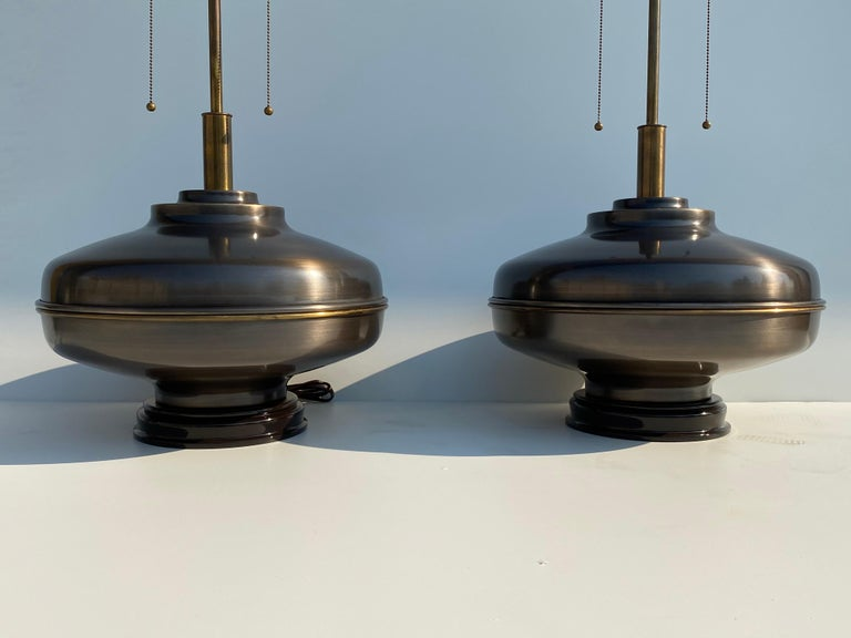 Pair of extra large lamps in antique brass finish.