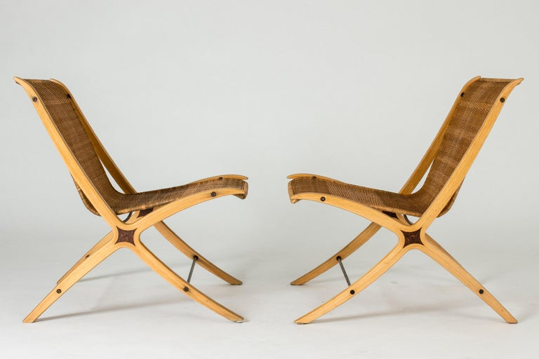 """Scandinavian Modern Pair of """"X"""" lounge chairs by Peter Hvidt and Orla Møllgaard For Sale"""