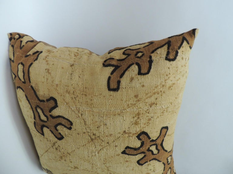 Pair of vintage yellow and brown African mud cloth decorative pillows, depicting tribal designs in shades of brown, deep yellows. Cotton backings. Boho-chic style accent pillows. Decorative pillows handcrafted and designed in the USA. Closure by