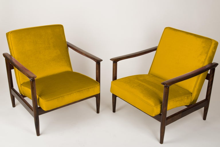 A pair of armchairs GFM-142, designed by Edmund Homa. The armchairs were made in the 1960s in the Gosciecinska Furniture Factory. They are made from solid beechwood. The GFM-142 armchair is regarded one of the best polish armchair design from the