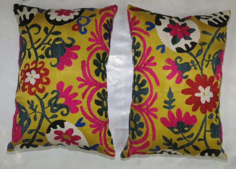 Pair of bright yellow handmade embroidered Suzanni textile pillows each measuring 13'' x 20'.