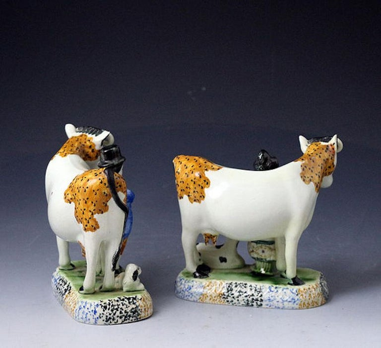 English Pair of Yorkshire Pottery Figures of Cows Prattware, Early 19th Century For Sale