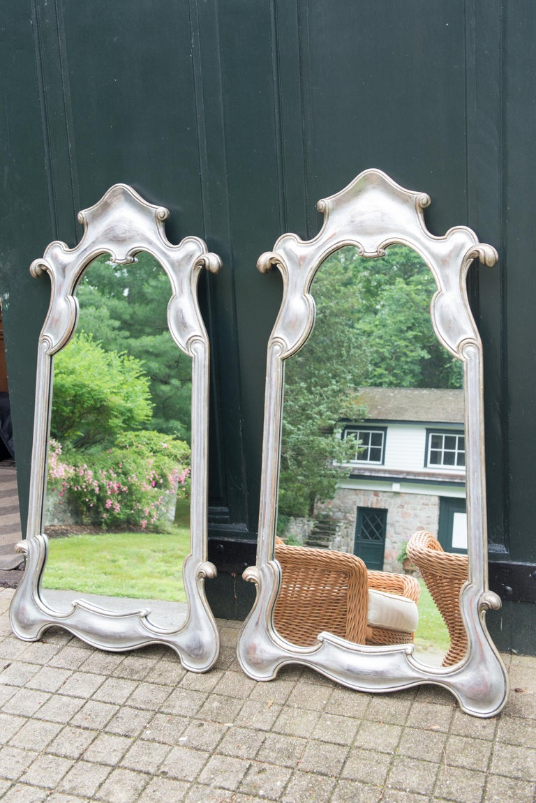 Whimsical Baroque style silver gilt carved wood mirrors from the 1950s. Substantial and good quality. Marked: Decorative Arts NY. Priced individually.