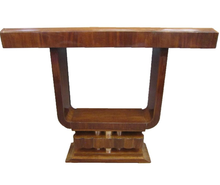 Price listed is per item .  $5,600 each / $11,200 the pair  A single or pair of fabulous original French modern petites consoles of open cube form, raised on stepped and fluted pediment bases. The negative area created in the center serves as a
