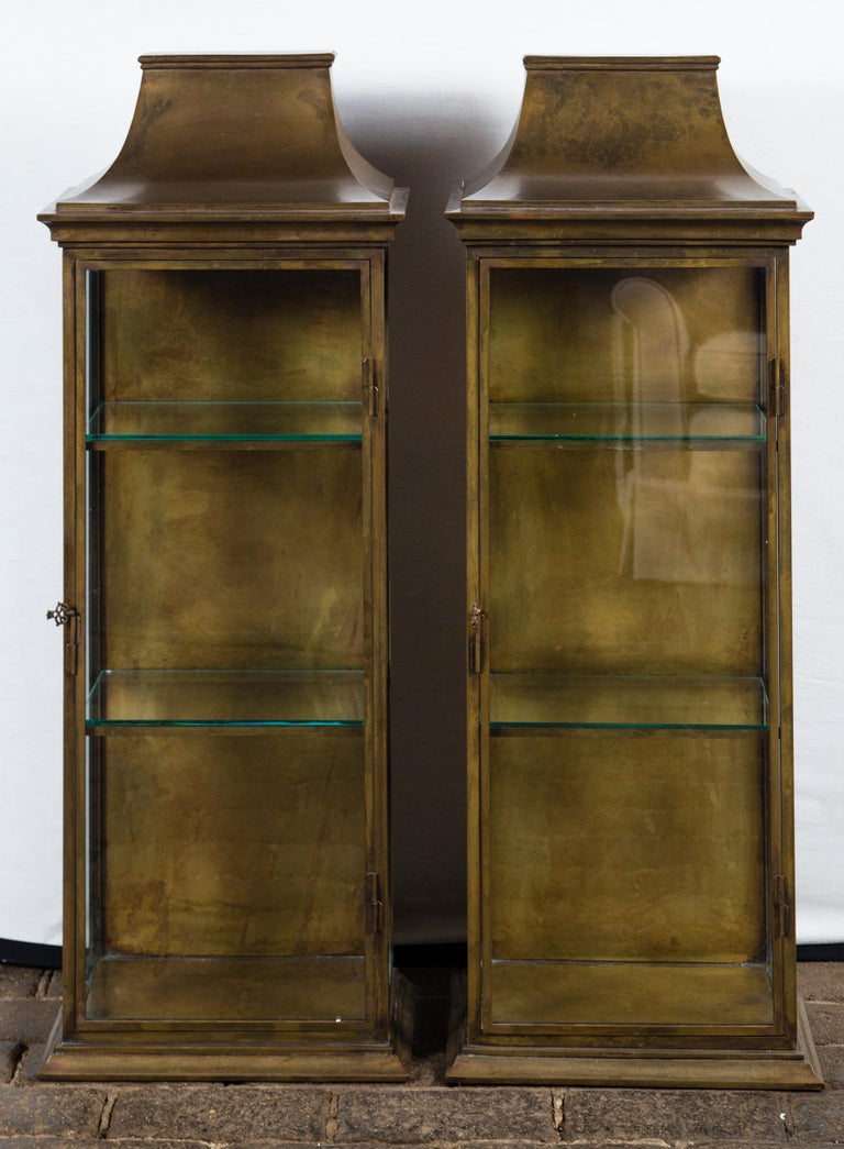 Pagoda style brass vitrine Chapman like quality. Interior shelf: 13.5 by 7 inches. Two hole for hanging on the back of vitrine. Only one available.