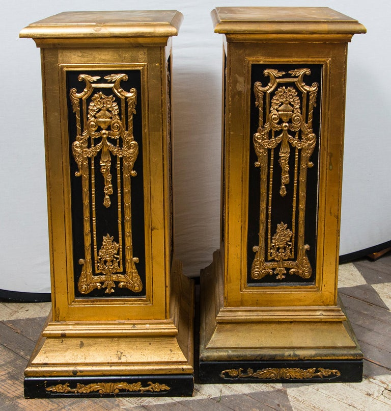 Painted in black and gold, with neoclassical carved wood designs gracing the sides. The tops are 14 inches square.