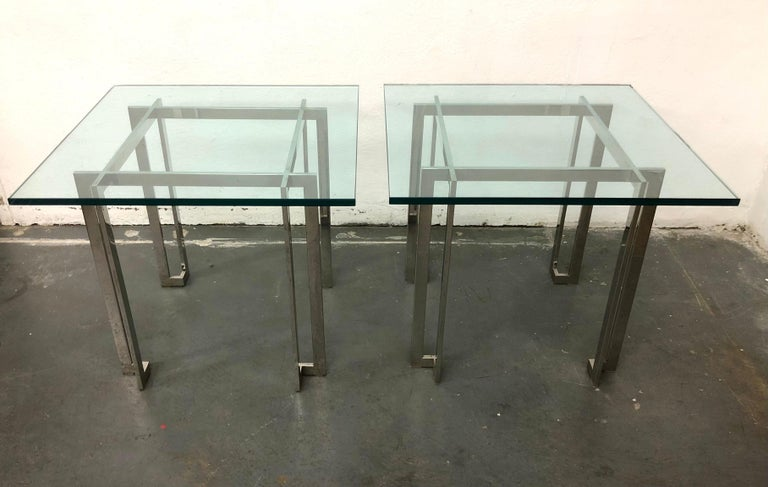 C. 1970s, chic architectural side tables in chromed steel with thick plate glass top. From the Estate of Herbert Kasper.