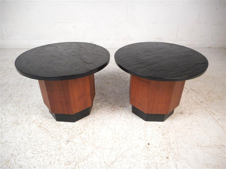 Stylish pair of midcentury tables with slate tops. Octagonal wooden pedestals with a black trim accent on the bases. Sure to impress in any modern interior. Please confirm item location with dealer (NJ or NY).