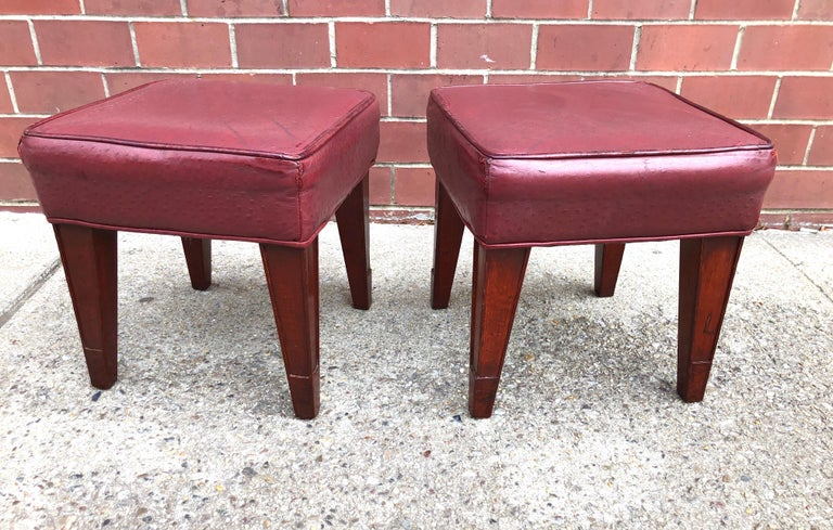 Mahogany stained wood, with burgundy Edelman ostrich leather seats, circa 1991. Two pairs available.