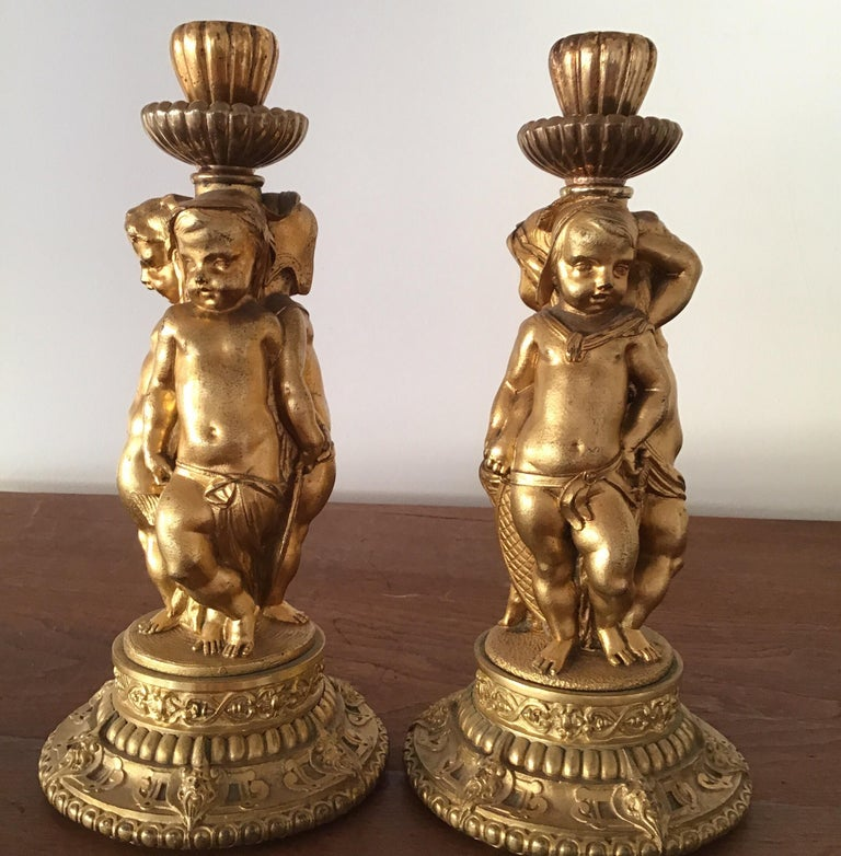 Pair of bronze ormolu  figural cherubs candlesticks Louis XV1  late 19th century mercury gilded with exquisite casting and details.