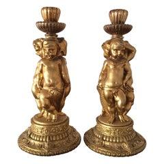 Pair of Figural Cherubs Ormolu   Candlesticks