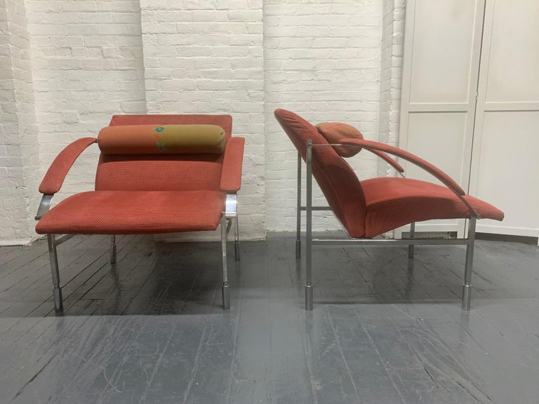 Pair of Italian chrome lounge chairs. The frame is steel and chrome-plated, has a detachable headrest and original fabric.