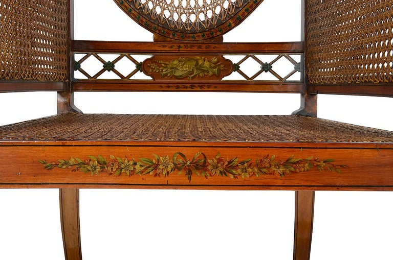 Mahogany Pair of Sheraton Revival Bergere Library Chairs, Late 19th Century For Sale