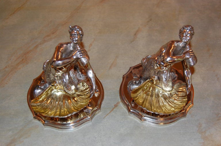 19th century pair of identical silver plated bowls feature a male mermaid or Neptune with twin fish tails, holding a seashell and supporting a larger scallop with gilt interior. Recently cleaned, polished and lacquered and in excellent condition.