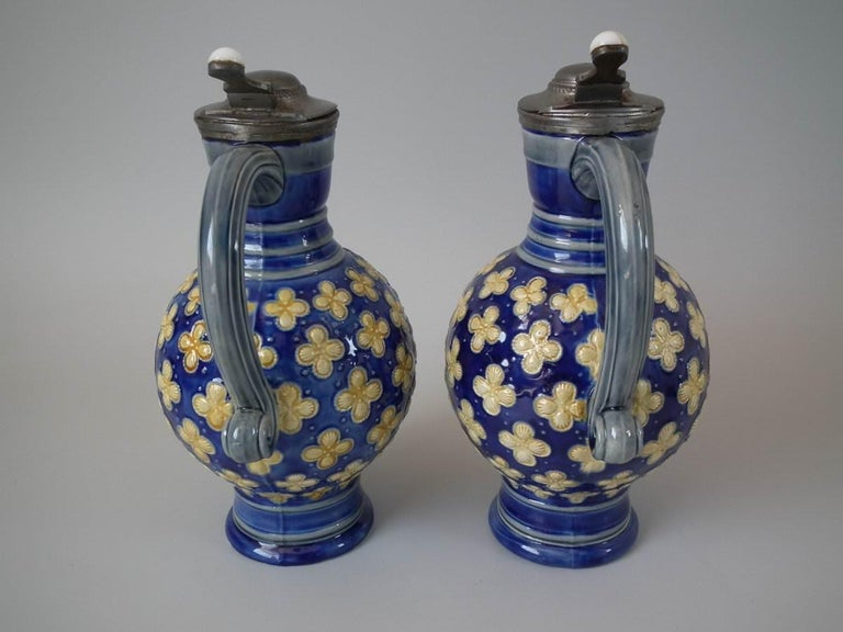 Pair Small Minton Majolica Pitchers With Mask Spouts For Sale 1