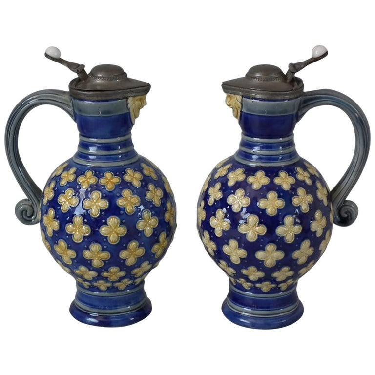 Pair Small Minton Majolica Pitchers With Mask Spouts For Sale