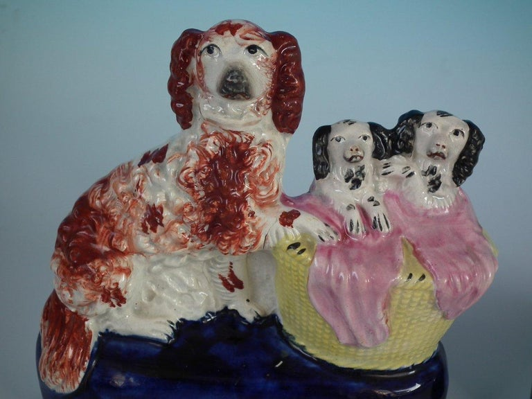 Pair of Staffordshire Spaniel and Pups in Wash Basket In Good Condition For Sale In Battlesbridge, Essex