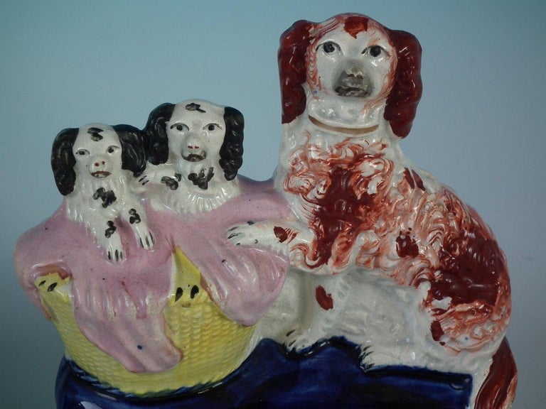 Mid-19th Century Pair of Staffordshire Spaniel and Pups in Wash Basket For Sale