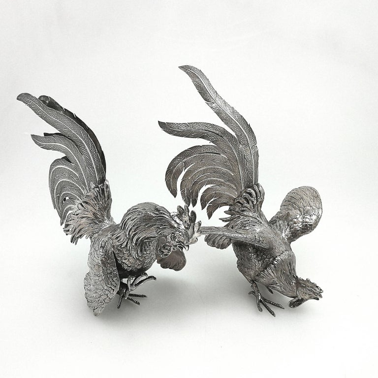 Pair of vintage solid silver table decorations in the shape of cockerels / roosters in an attitude of fighting. These fighting cockerels are created with a wonderful attention to detail with close attention paid to the feathers and plumage. Both