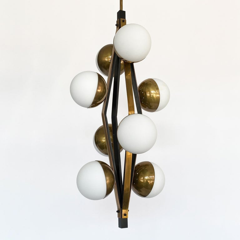 Mid-Century Modern Pair of Stilnovo Brass Eight Globe Pendant Chandeliers For Sale