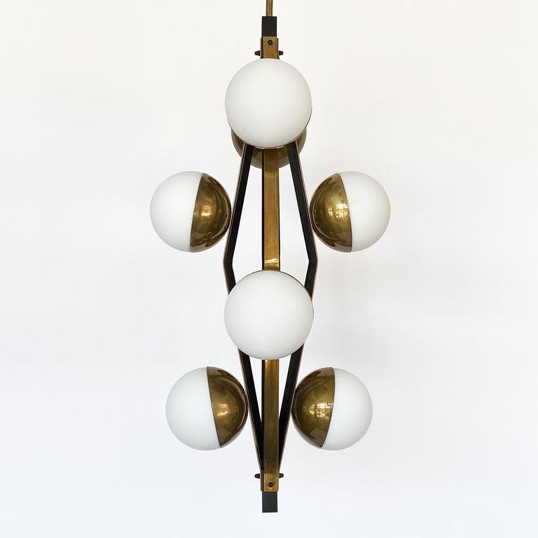 Blackened Pair of Stilnovo Brass Eight Globe Pendant Chandeliers For Sale