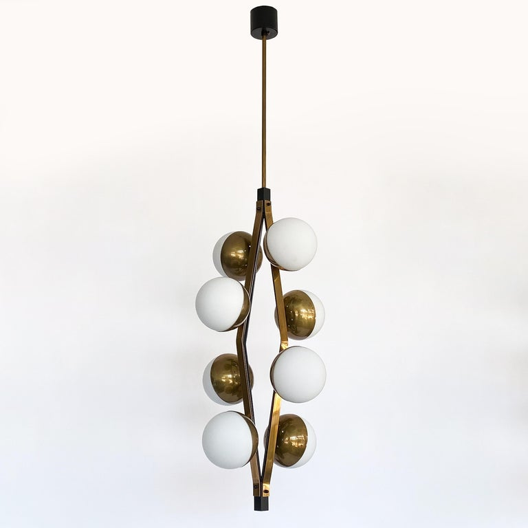 Pair of Stilnovo Brass Eight Globe Pendant Chandeliers In Good Condition For Sale In Chicago, IL