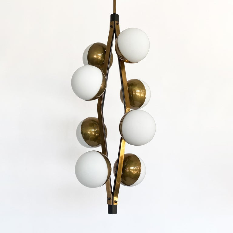 Mid-20th Century Pair of Stilnovo Brass Eight Globe Pendant Chandeliers For Sale